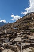 foto of mustang  - Rooftop view over Marpa village - JPG