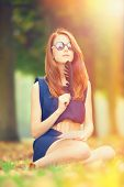 picture of versaille  - Redhead girl sitting in the Versailles park - JPG