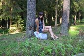 Young brunette woman posing for the camera in the forest