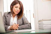 Female Lawyer Signing Documents