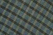 foto of asymmetric  - Blue and brown plaid print as background - JPG