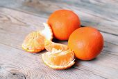 image of clementine-orange  - Orange tangerines on a wooden table. Vitamins nutrition