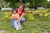 Mother Holding Her Daughter In The Park