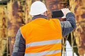 Building inspector start filmed with tablet PC