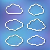 Set of clouds, linear illustration on bright blue blurred background