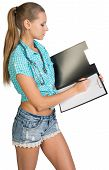 Woman with stethoscope writing on blank clipboard