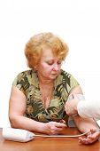 Old Woman Measures Arterial Pressure.