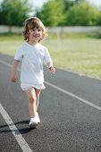 cute girl running at stadium photo