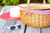 Ready For Summer Weekend. Sunglasses Hat And Wicker Basket.