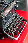 Old Retro Black Metallic Typewriter With Antique Round  Keys.