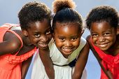 Small African Girls Joining Heads.
