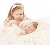 stock photo of sleeping  - Baby Girl and Newborn Boy Sister Little Child and Sleeping Brother New Born Kid Birthday in Family Love Concept - JPG