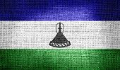 Lesotho flag on burlap fabric