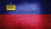 Liechtenstein flag on burlap fabric