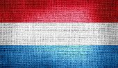 Luxembourg flag on burlap fabric