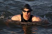 stock photo of breast-stroke  - A man doing the breast stoke outdoors - JPG