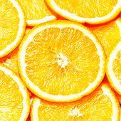 Orange Background. Slices Of Fresh Orange Fruit  Closeup. Healthy Food. Background.
