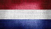 Netherlands flag on burlap fabric