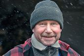 Happy Man In A Knitted Winter Cap