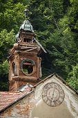 Old Abandoned Wooden Town Hall With Clock In Slovakia