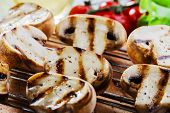 image of grill  - Grilled mushrooms with sauce on the grill vegetables - JPG