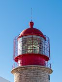 Red Lighthouse On The Background Of Blue Sky