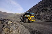 foto of mines  - The big diesel lorry takes out iron ore from an open - JPG
