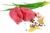 picture of boeuf  - Cut of beef steak with garlic slice onion and laurel - JPG