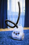 Vacuum Cleaner Stand  On Blue Carpet.