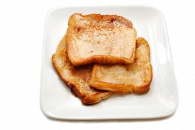 image of french toast  - Three Slices of French Toast on a White Plate - JPG