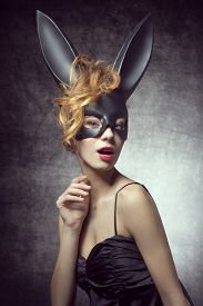 picture of bunny costume  - Beautiful sexy charming woman in carnival black costume of bunny with wild hairstyle and red lips - JPG