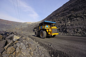 foto of iron ore  - The big diesel lorry takes out iron ore from an open - JPG
