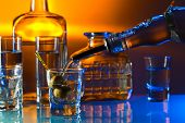pic of vodka  - vodka with olives in bar on a glass table - JPG