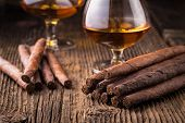 picture of cigar  - quality cigars and cognac on an old wooden table - JPG
