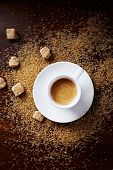 stock photo of sugar  - Cup of black coffee on brown sugar - JPG