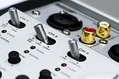 stock photo of toggle switch  - Detail of silver DJ mixer controller with buttons - JPG