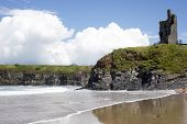 image of children beach  - young child on the beach with cliffs and castle on ballybunion beach county kerry ireland - JPG