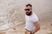 picture of beard  - Young handsome bearded man on the beach - JPG