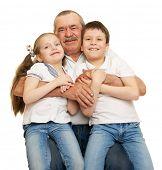 stock photo of grandfather  - Grandfather and grandchildren portrait studio shoot - JPG