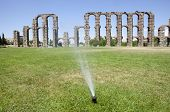 pic of aqueduct  - Grass Sprinklers wtih Roman Aqueduct of Merida at the bottom. Extremadura Spain