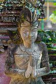 stock photo of hindu  - Statue in Pura Taman Ayun  - JPG