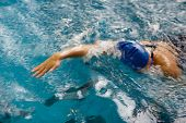 picture of crawl  - Female swimmer in an indoor swimming pool  - JPG