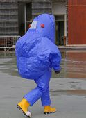 picture of biological hazard  - man with blue protective gear against biological risk - JPG