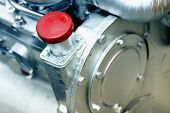 image of lube  - Close up of cap screw on the engine - JPG