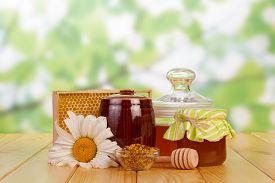 foto of honeycomb  - Honey in jar with honey dipper - JPG