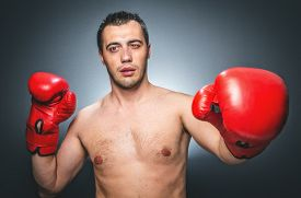pic of knockout  - Funny boxer man in knockout over dark gray background - JPG