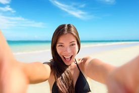 picture of selfie  - Selfie fun woman taking photo at beach vacation - JPG