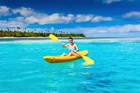 stock photo of kayak  - Woman Kayaking in the Ocean on Vacation in tropical Fiji island - JPG