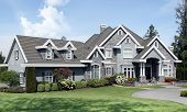 Beautiful luxury mansion with manicured front lawn.  poster