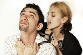 Woman  Strangling A Young Man Tie